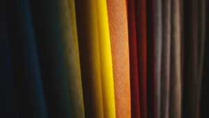 different coloured cloth on a rack
